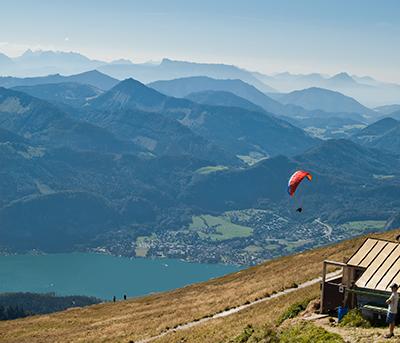 Paraglider from Schafberg, Salzkammergut, Austria.