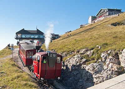 Schafbergbahn steam train approaching summit station.